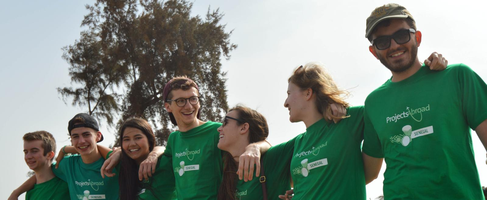 Group of volunteers smiling and enjoying their project abroad